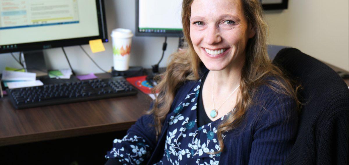 Dr. Kruse-Jarres sitting at her desk.